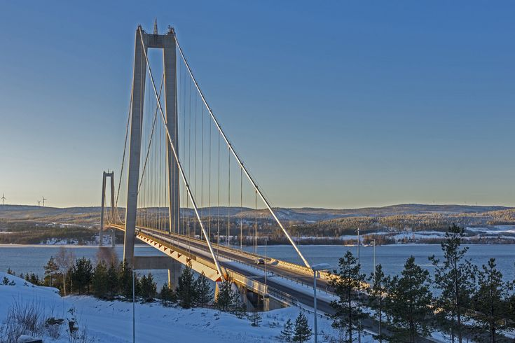 Bridge in midwinter sun, picture from a part of the High coast a UNESCO World Heritage site in the Gulf of Bothnia in the North of Sweden.