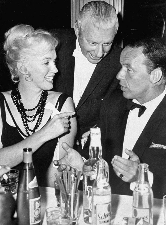 Marilyn Monroe talks to Frank Sinatra during a party on the set of the musical 'Can-Can' in this 1960 file photo. (AP Photo/Columbia Pictures, File)