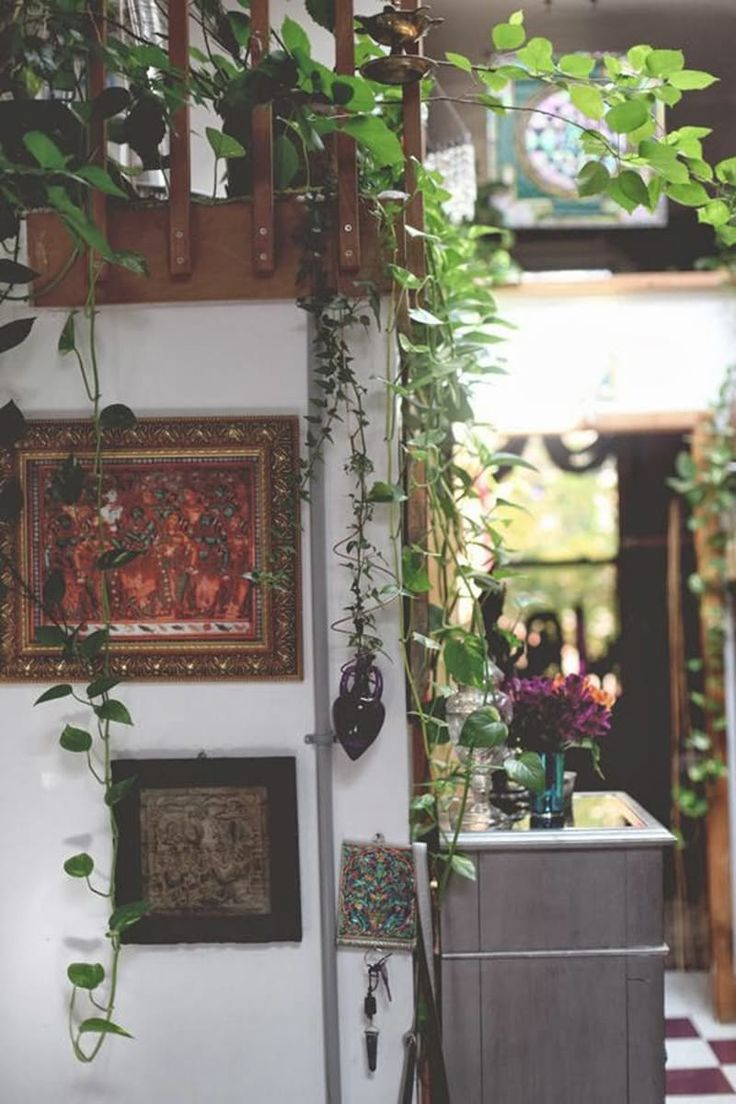 Two things a bohemian space can never have enough of: plants and art, as demonstrated by the entryway spot above from Free People.