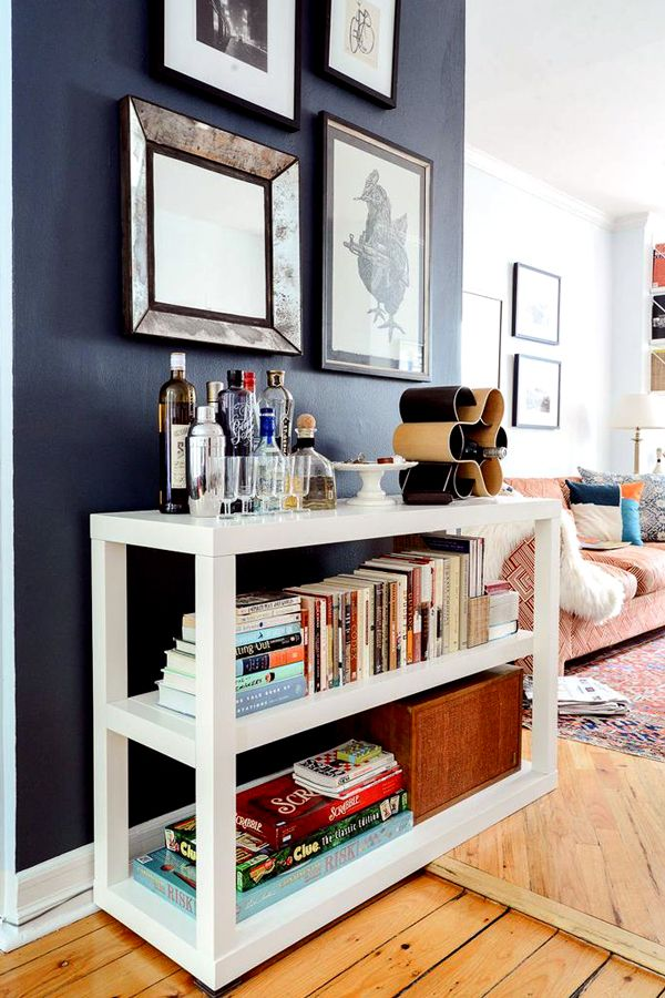 This Small Brooklyn Apartment Feels Comfortable, Not Cramped #refinery29  http://www.refinery29.com/homepolish-writers-brooklyn-retreat#slide-6  With limited space, I ended up placing my bar materials, favorite books, and board games on one three-shelf unit.