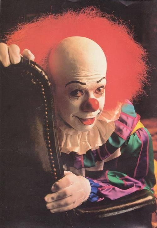 Tim Curry as Pennywise The Clown from Stephen King's IT. I am forever checking drains over 30 years since reading the book. Great villan, not a good clown, scary clown!!!