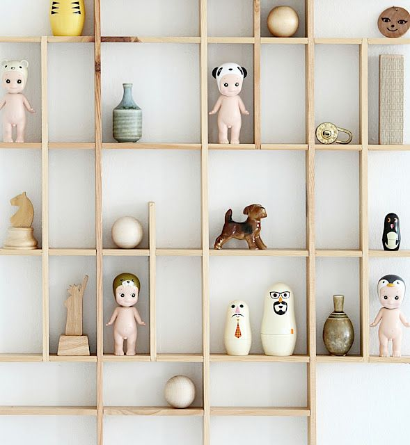 This is a fabulous idea for displaying wee fabulous things. I have a set of these animal head kewpie doll dudes (they just make me squee with delight) but they are still in their box.
