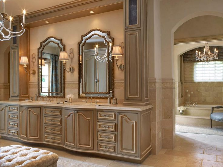A Large Neutral Vanity With Detailed Molding Frames Two Elegant Mirrors,  Which Are Separated By