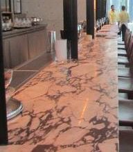 photo 5:This beautiful counter is made with the black and white marble and it looks beautiful and shinny .