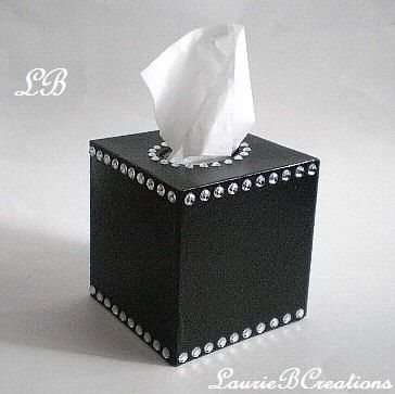 Cover your tissue box w/ unique style and sparkle! This black & bling tissue box cover gives a sparkling touch to the bathroom, bedroom, office or anywhere. It is made out of smooth solid paper mache that is handpainted on the inside and outside with a non toxic glossy acrylic paint. It is accented with clear rhinestones. It has an open bottom to fit right over any standard square tissue box. Measures 5 x 5 x 5 1/2. Matches well w/ other black or bling decor! If you like de...