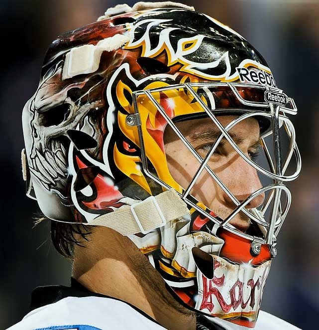 NHL Goalie Masks By Team | ... Calgary Flames - NHL Goalie Masks by Team (2010-11) - Photos - SI.com
