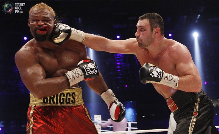 WBC boxing champion Vitali Klitschko (R) of Ukraine lands a punch on Shannon Briggs of the U.S. during their WBC Heavyweight Championship boxing bout in Hamburg October 16, 2010. Klitschko won the fight by points after twelve rounds. REUTERS/Christian Charisius