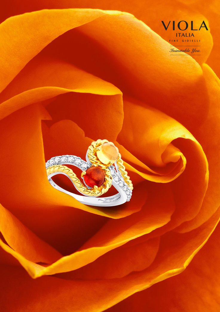 Gently held in the folds of brightness, this #Red Garnet and #Orange Citrine are opposite forces complimenting each other. #PhotoShoot #Shoot #Ring #Jewel #ViolaItalia
