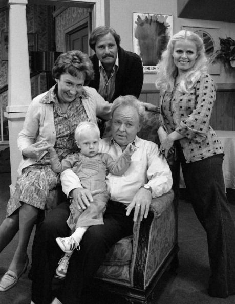 FAMILY cast members Rob Reiner Sally Struthers Carroll O'Connor holding Jason Draeger and Jean Stapleton