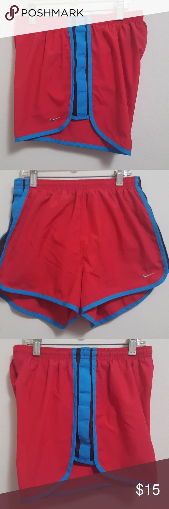 Nike women's drifit running shorts VERY GOOD CONDITION! Size small. Very minor to no flaws. Red shorts with sky blue trim with hint a of burgundy mesh on the sides. White inner lining with inner pocket in front.   Great for workout shorts or any active activity.   No trades. Bundle to save on shipping!  Offers are welcomed through offer button only Nike Shorts