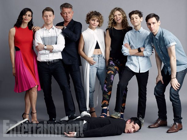 The cast of Gotham (L-R) Morena Baccarin, Ben McKenzie, Sean Pertwee, Camren Bicondova, Erin Richards, David Mazouz, Cory Michael Smith and Robin Lord Taylor (on the floor)