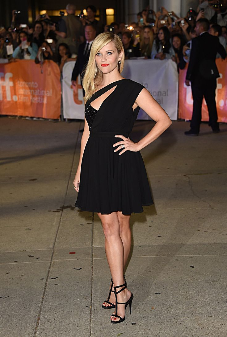 """Red Carpet Watch: Reese Witherspoon - NYTimes.com Her legs were on display with this dramatically slashed Saint Laurent frock chosen for the """"Wild"""" premiere the following night. (Photo: Jason Merritt/Getty Images)"""