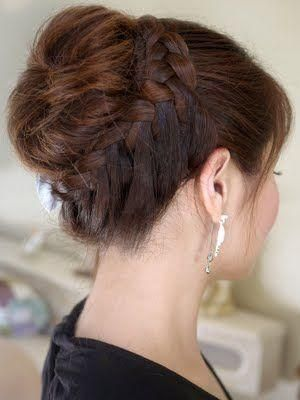 messy bun with wrap around braid