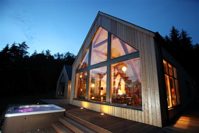 Stunning waterfront holiday house on the west coast of Scotland.  Best sealoch hot tub views ever.  Boat access only.  Floor to ceiling glass.  Sleeps 10.  An idyllic hideaway.