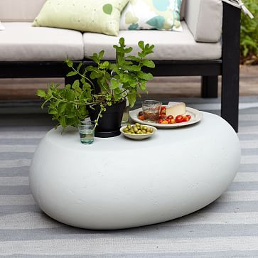very nice $299. 24x36 made out of concrete so heavy.  Pebble Coffee Table