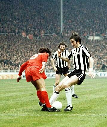 Liverpool 3 Newcastle Utd 0 in May 1974 at Wembley. Peter Cormack and Frank Clarke in action in the FA Cup Final.