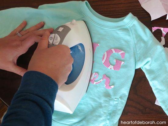 Create a fun pregnancy announcement by making this DIY big sister shirt!