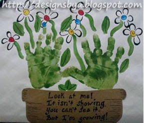 hand print flowers - kid craft... you could put pictures of the child's face as the middle of the flowers!