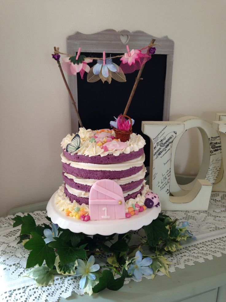 Enchanted garden cake with fairy washing line