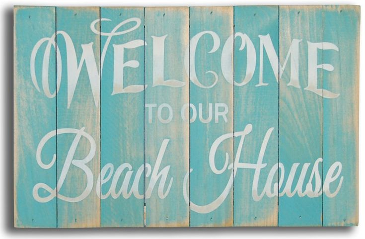 """Adorable for summer, welcome guests to your the beach house! 8""""x12"""" teal washed slat beach sign with off white wording """"Welcome to our Beach House""""."""