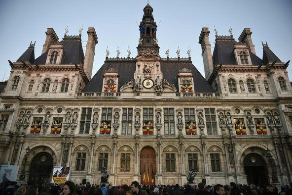 Belgian flags were displayed at City Hall in Paris on Tuesday.