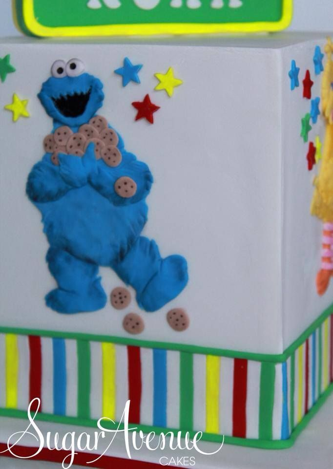Sesame Street cube cake with cute Sesame Street characters on four sides of cube. Elmo, Bert, Ernie, Big Bird and Cookie Monster.