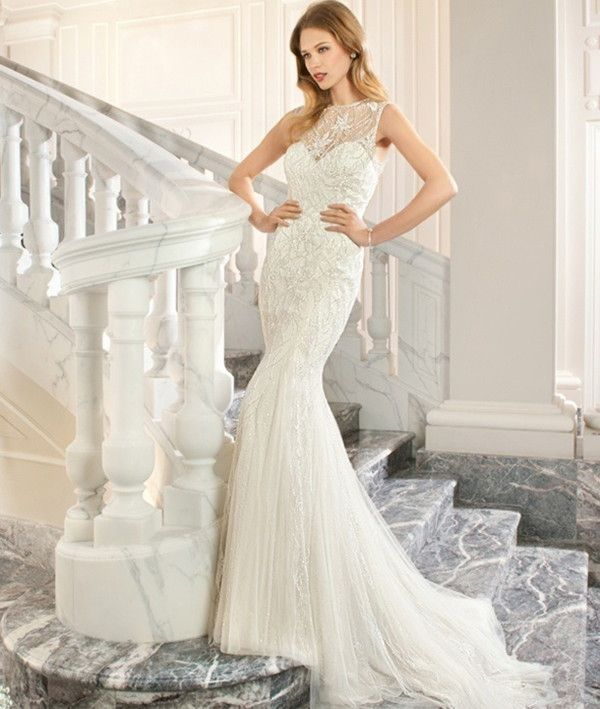 Lovely sweetheart neckline and sheer illusion top accent wedding dress | Demetrios Couture 2015 Bridal Collection via @WorldofBridal