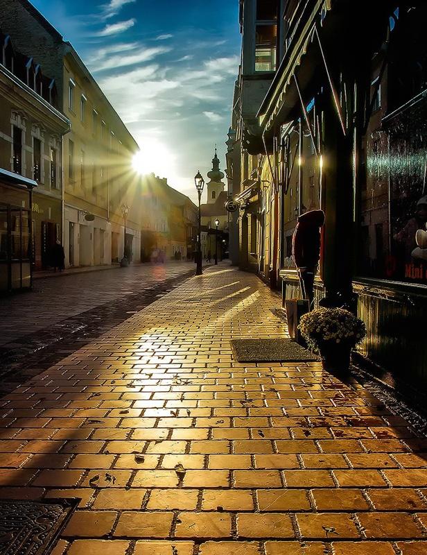 sunrise / old city street . gyor/hungary