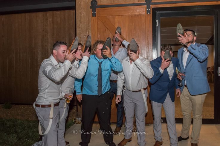 Wedding photographer, Candid Photos of a Lifetime  the groom & his mates drinking a beer out of their shoes