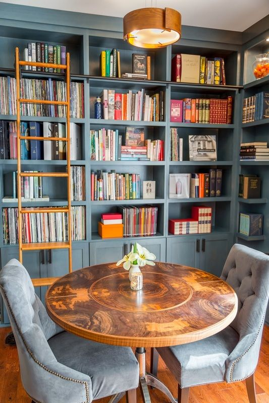 dusty blue painted library shelves so the books don't compete, Harmony Weihs, Design Harmony, photo by Cory Holland.