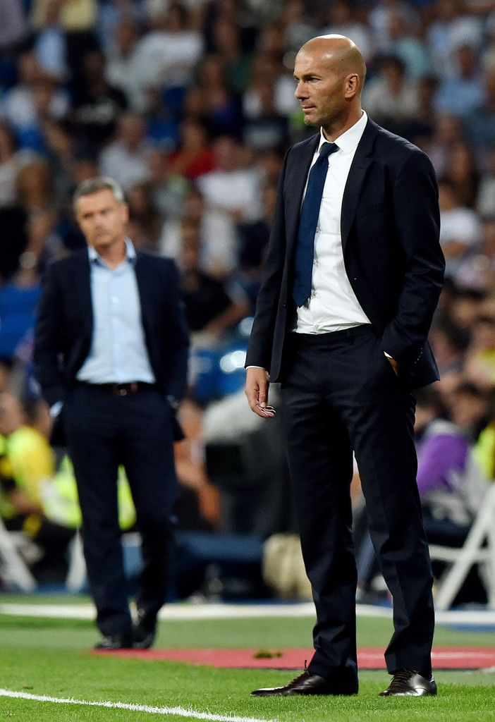 Real Madrid's French coach Zinedine Zidane stands on the sideline during the Spanish league football match Real Madrid CF vs Villarreal CF at the Santiago Bernabeu stadium in Madrid on September 21, 2016.