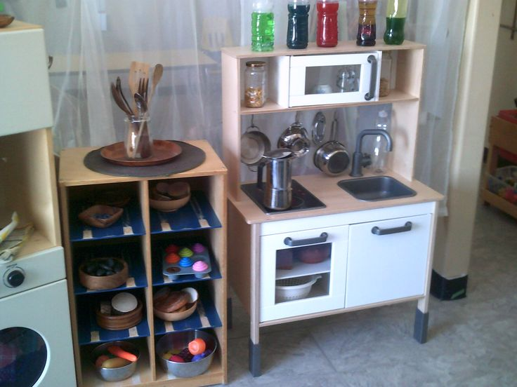 MTJB-Kemptville- Rocks and other natural loose parts are offered for use in this dramatic play area kitchen.