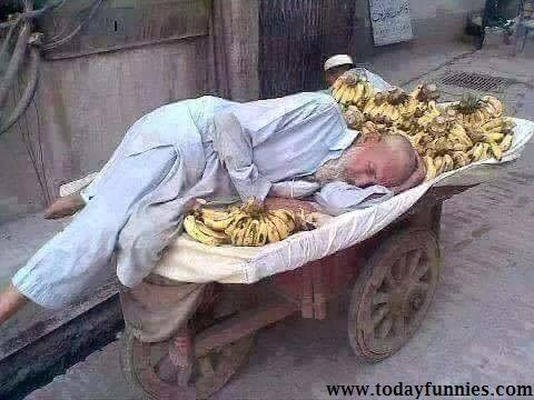 This Is Very Awesome Picture Of A Pakistani Poor Old Man Selling Bananas. In This Amazing Picture A Pathan Old Man Is Sleeping As Well As Selling Bananas On Handcart. He Is Doing This Job To Survive Not To Become A Millionaire. I Am Not Getting Happy To Share This Picture…I Just Want To Give A Message To All People Around The World That If You Buy Anything Like Fruits Or Vegetables ETC…Then Plz Prefer To Buy These Things From Such Type Of Poor People.