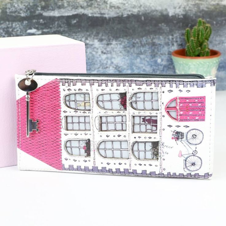 How fabulous is this wallet from Disaster Designs? In an intricate illustrated house design with cut out window details, it opens up to reveal 3 note slots, 13 card slots, and 1 ID window.A zipped pocket with key pull reveals space for coins and it closes with a popper fastening. What's more? For an additional £6 this purse can be personalised with a silver plated heart charm with up to 10 characters, attached to the zip pull. affiliate link for noths