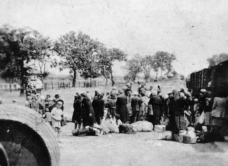 _1Soltvadkert, Hungary, Jews, being deported by Hungarian gendarmes, about to boarding a deportation train.