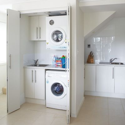 To fit a laundry and kitchen into a space less than 12m2 the designer of this two-storey flat made maximum use of space by nestling the kitchen under a staircase and tucking the laundry inside a cupboard. | Handyman Magazine |
