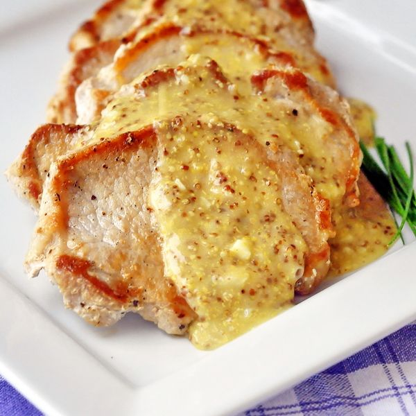 Pan Seared Pork Chops with Dijon Butter Sauce - simple, juicy seared pork chops with an easy dijon butter pan sauce. A recipe equally good to serve guests or as a quick and easy weekday family dinner.