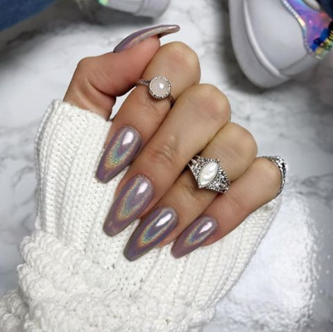 "This ""UNICORN"" Holographic Nail Pigment Powder is so easy to use and so cheap compared to going to the salon. Apply over pink, blue, purple, black, white, any color - and see the magic of holo nails happen!"