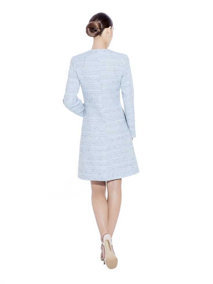 Turn heads in this crisp light blue handwoven premium boucle tweed coat with long slim sleeves and hidden fastening. This coat is effortlessly chic and makes the perfect companion to the matching boucle tweed skirt. Handwoven boucle fabric imported from France with 100% viscose lining. Washcare: Dry clean MADE IN EUROPE