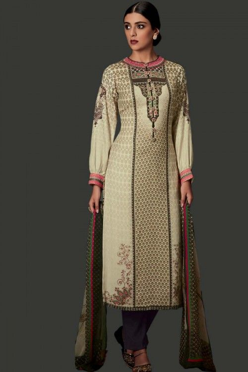 Cream Pure Pashmina Trouser Suit With Dupatta Cream printed Pure Pashmina semi stitch trouser suit.Round neck, Below knee length, full sleeves kameez. Gray pure pashmina trouser. Cream and Green chiffon dupatta. Product are available in 34,36,38,40 sizes. It is perfect for Festival Wear,Party Wear.    http://www.andaazfashion.co.uk/salwar-kameez/trouser-suits