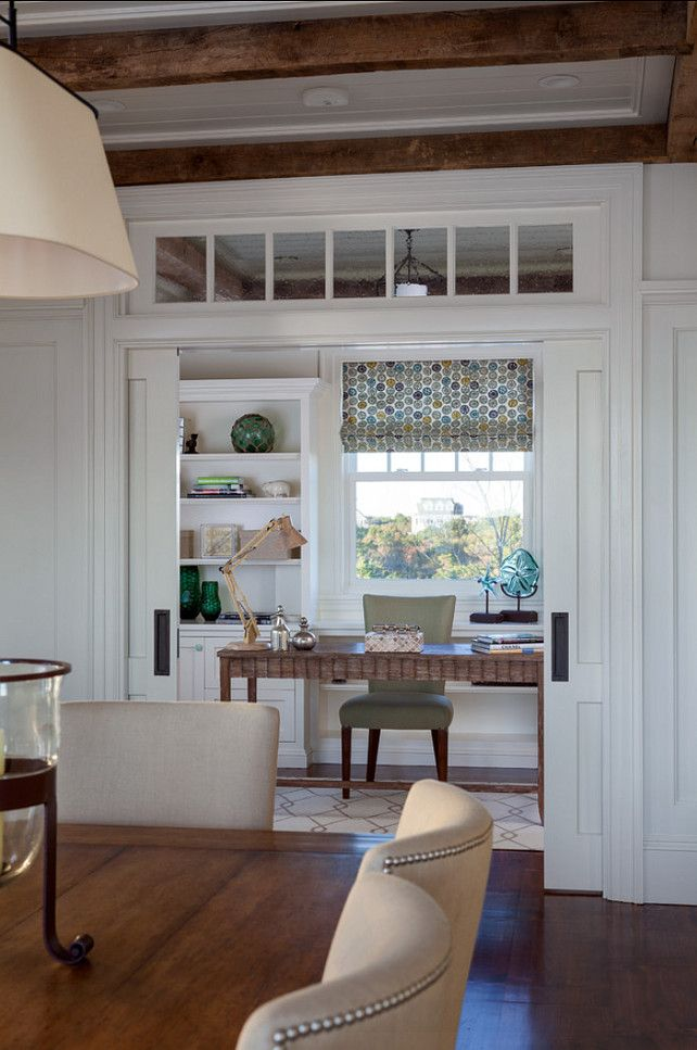 Home Office. Gorgeous home office with coastal decor. Double pocket doors with transom separates the dining room from a stylish home office. #HomeOffice #CoastalDecor