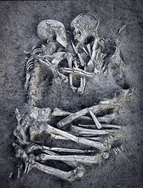 """Archaeologists found another skeleton nearby, suggesting the couple were in a prehistoric burial ground. While the single body was buried East-West, possibly following the daily path of the sun across the sky, the Stone Age couple were buried """"the wrong way"""".  """"They were buried North-South, and we don't know why,"""" said archaeologist Daniela Castagna, standing over the grave site.  John Robb, lecturer at Cambridge University"""