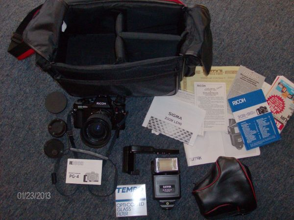 RICOH KR-30sp 35mm CAMERA & SIGMA LENS f=35-70MM **plus** in EDWATERS Garage Sale in Plant City , FL for $50.00. THIS VINTAGE 35mm CAMERA  LENS IS PRICED TO SELL. IT LOOKS TO BE IN GOOD CONDITION. THIS PACKAGE INCLUDES THE RICOH KP30sp PROGRAM CAMERA, MANUALS, CAMERA STRAP, SIGMA ZOOM MASTER F=35-70mm LENS, TEMPO PLUS 52mm UV LENS FILTER. SUNPAK AUTO DX30 FLASH, RICOH PG-4 WINDER, SIGMA CAMERA CASE  FOTIMA BAG. IM ASKING 50.00 OBO. ARRANGEMENTS CAN ALSO BE MADE TO ...