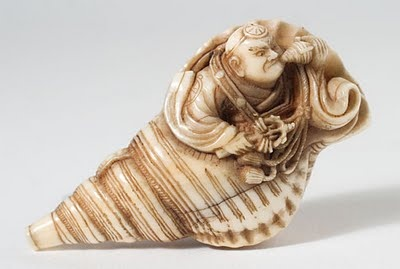 19th century elephant ivory netsuke  Benkei Blowing a Conch Horn by Anonymous    Benkei is considered to be one of the great warriors  of Japan and is known to have been the sidekick of the  greatest warrior, Yoshitsune. In this design there is the  form of a large conch shell horn which is blown to signal  the beginning of a charge on the battle field