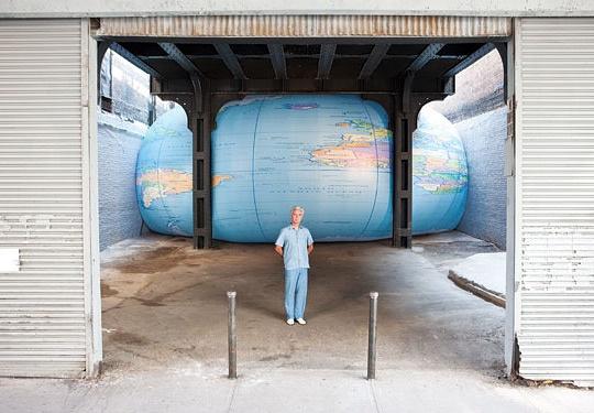 giant globe smooshed under a bridge?