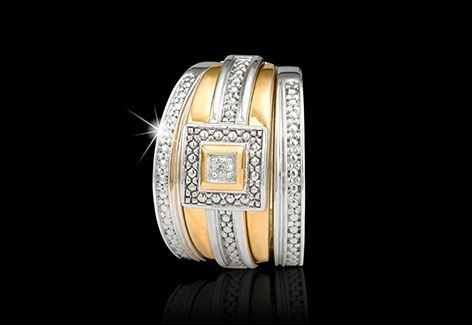 A 9ct yellow gold and diamond wedding set with diamond detailing in the centre and down the sides.