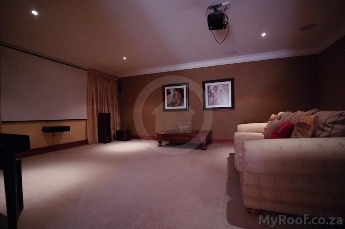TV - living room in Exclusive Estate Homes found on MyRoof.co.za