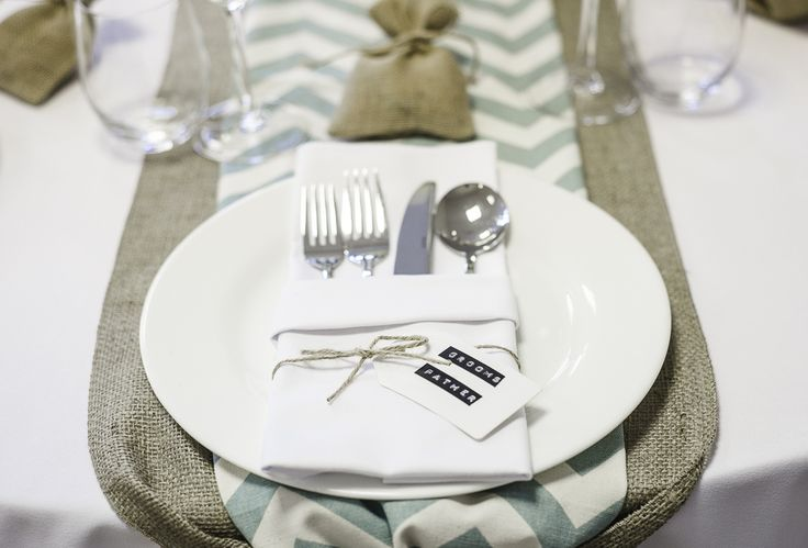 Chevron mint table runner over hessian table runner and hessian jute favour bags perfect for a spring themed wedding