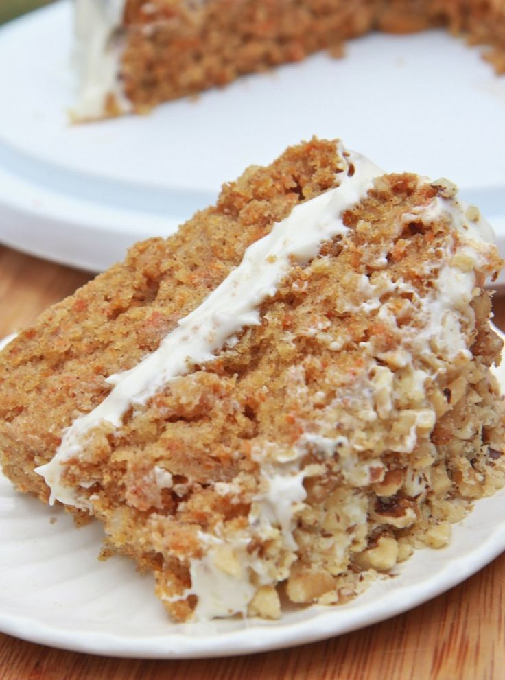 Moist & Fluffy Gluten-Free Carrot Cake Recipe _ bakes up light, fluffy and moist just the way a carrot cake should! It's lightly spiced with just the right amount of cinnamon & sweetness to pair up with that silky cream cheese frosting.
