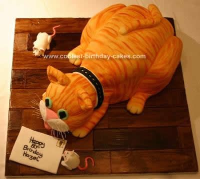 Homemade 3D Cat Cake: This 3D Cat Cake was a carved vanilla sponge cake with jam and vanilla buttercream. The buttercream was spread over the outside of the cake to help it